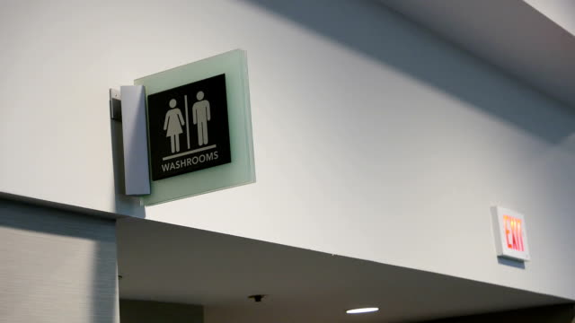 Motion of man and woman washroom logo on wall video