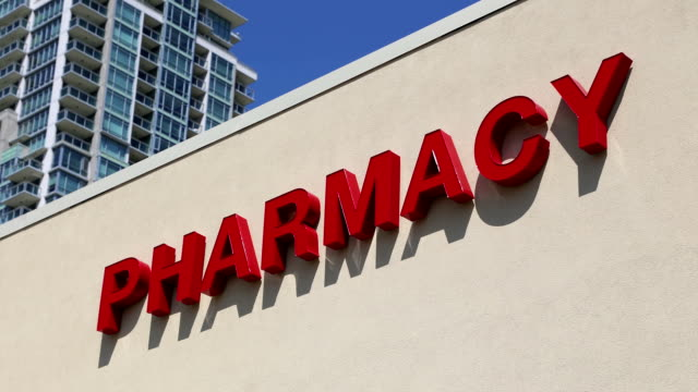 Motion of pharmacy sign on building video