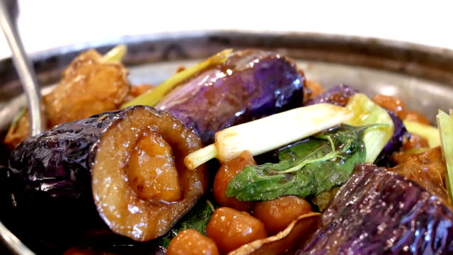 Motion of stewed chinese yam and eggplant on table inside Chinese restaurant video