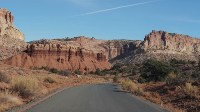 Motion On An Empty Rural Road To Red Mountain Rocks Buttes In Dry Desert Valley