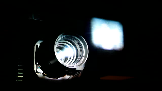 Motion picture projector lens, power beam shine through glass and optic video