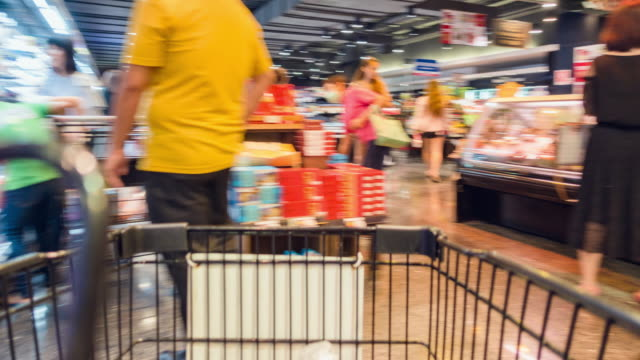 Motion Shopping in a supermarket. Shopping Cart view of Grocery time lapse. Motion Grocery Cart Time Lapse in Supermarket. 4K Resolution. shopping cart stock videos & royalty-free footage