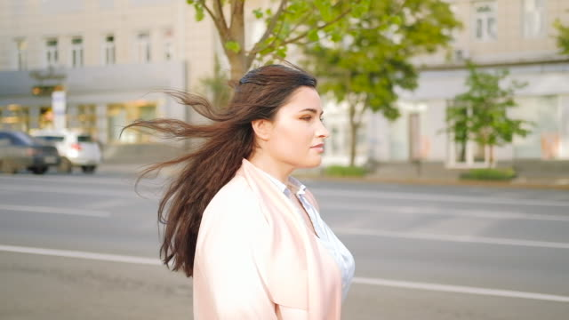 motivated woman walking city stylish confident
