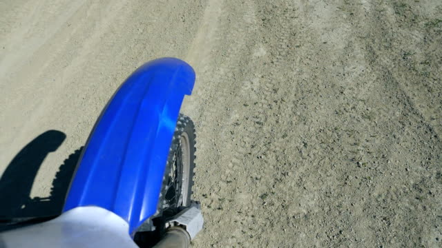 motocross bike slowly rides. point of view from the wing of a motorcycle. slow motion close up - supercross video stock e b–roll