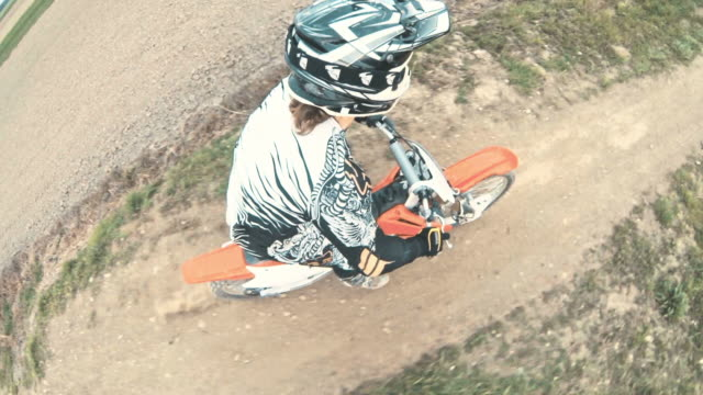 slo mo pov motocross competition on a dirt track - supercross video stock e b–roll