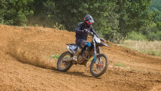 motocross racer riding on dirt track - supercross video stock e b–roll