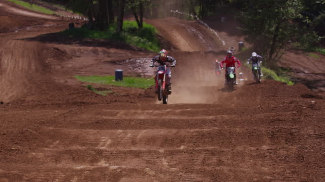 motocross racers going over bumps - motocross video stock e b–roll