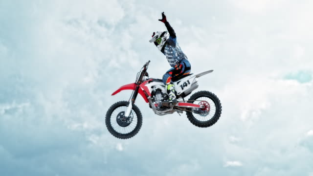 speed ramp motocross rider doing a no hand trick - motocross video stock e b–roll