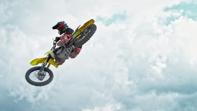 speed ramp motocross rider jumping into air - motocross video stock e b–roll