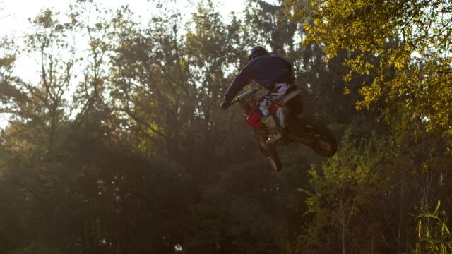 Motocross rider jumps on dirt road track video