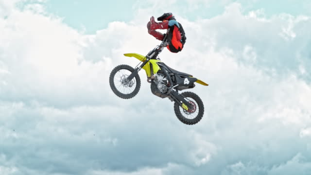 speed ramp motocross rider performing a jump trick - motocross video stock e b–roll