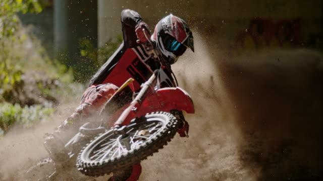 MS Motocross rider speeding, sliding on dirt course