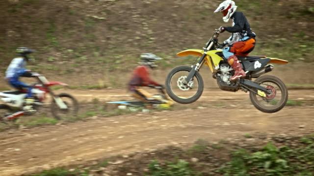 slo mo motocross rider training in dirt park - supercross video stock e b–roll
