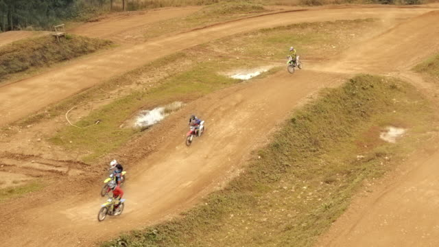 aerial motocross riders riding in a competition - supercross video stock e b–roll