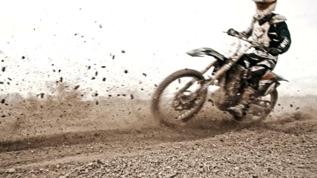 SLO MO Motocross riders riding through the turn video