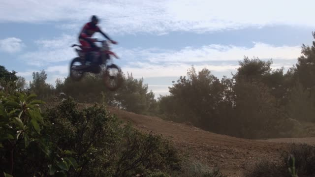 Motocross sports and practice at the forest, 3 motocross athletes are performing a jump with their motorbikes video