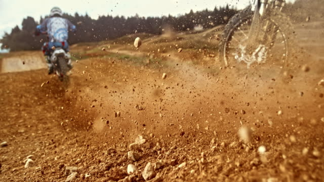 speed ramp motocross tire riding on gravel - motocross video stock e b–roll