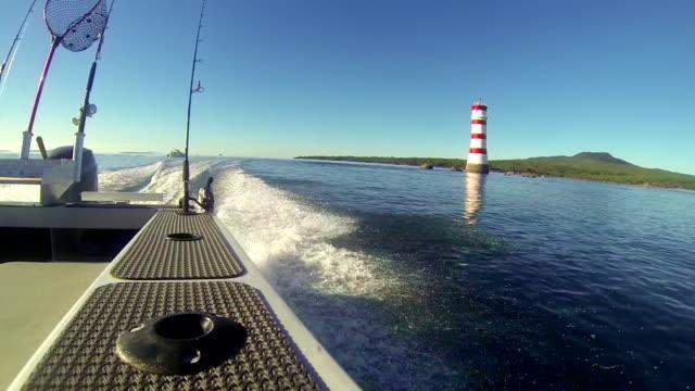 Motor boat fisheye view passing lighthouse, Rangitoto Island, New Zealand. video