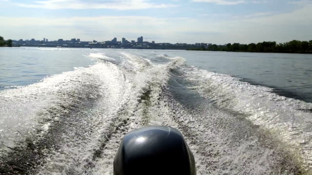 Motor boat floats on the river video