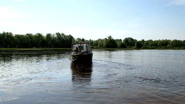 Motor boat leaves from the banks of the river video