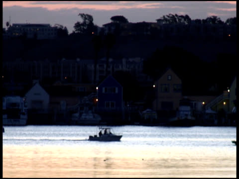 Motor Boat Passes Glistening Sunrise /Sunset Water video