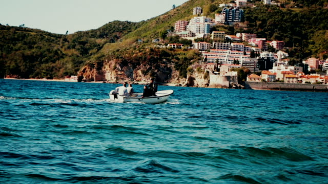 Motor boat ride on sea with people video