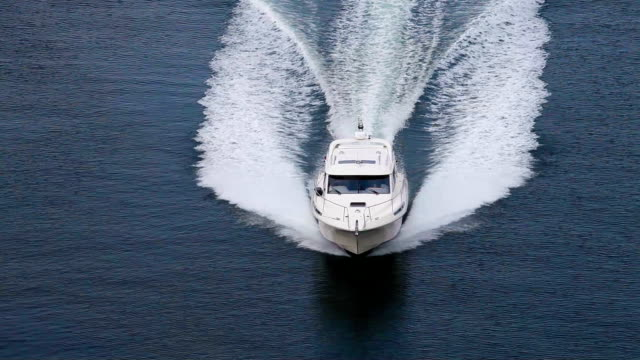 Motor boat rides on the water Motor boat rides on the water military private stock videos & royalty-free footage