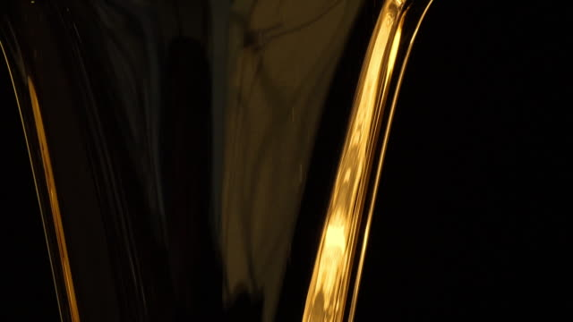 Motor oil pouring on black background. Slow motion