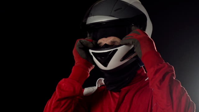 Motor racing / Formula One Driver / Go-Carting putting on Helmet video