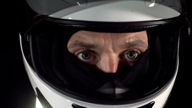 Motor racing / Formula One Motorbike Driver visor close up video