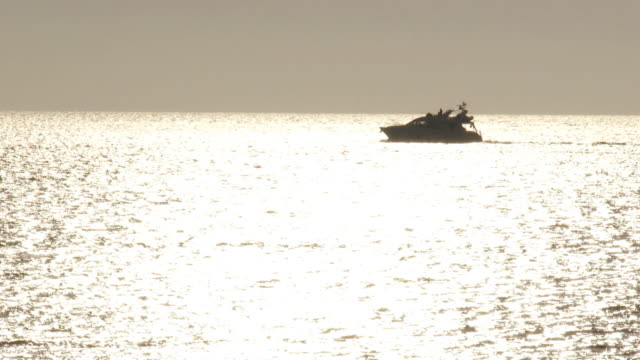 motor yacht in the sunset sea video