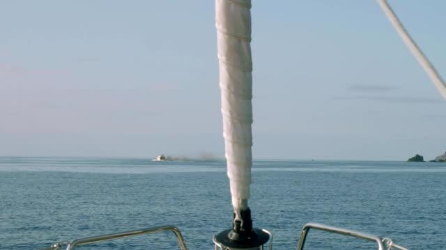Motor yacht sails away leaving black exhaust video
