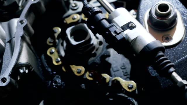 Motorbike motor in details Close-up. The motorcycle motor in details. Dissassembling engine from sport motorbike. Repairing the motorcycle in auto garage. Steel parts from motor. crank mechanism stock videos & royalty-free footage