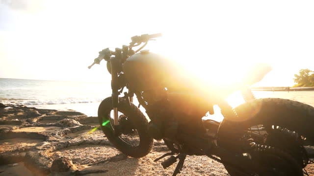 Motorbike on the beach during sunset video