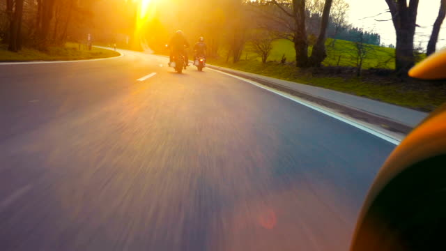 motorbike on the road in nature Landscape motorbike on the road riding. having fun driving the empty road on a motorcycle tour journey. point of view shot motorcycle stock videos & royalty-free footage