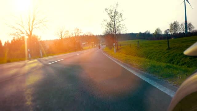 motorbike on the road in nature landscape - viaggio d'istruzione video stock e b–roll