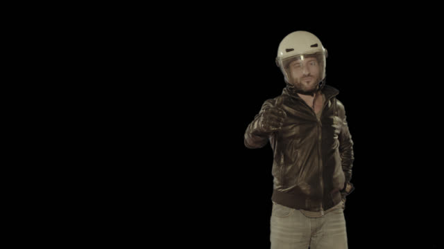 Motorbike rider wearing helmet. Isolated clip alpha channel available in 4k version