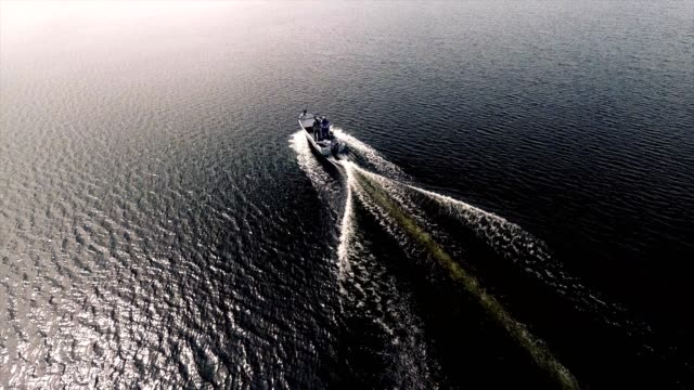 Motorboat driving - aerial footage video