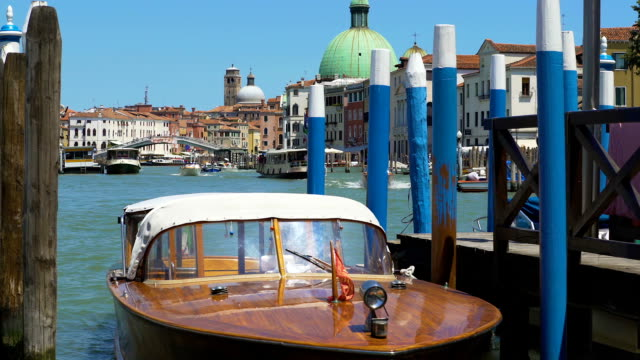 Motorboat tied up at the shore, water transportation on Grand Canal, marine tour video