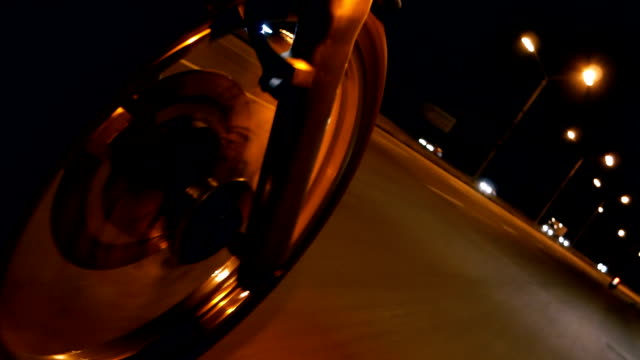 Motorcycle. A motorcycle wheel close-up on a night road. Motorcycle. A motorcycle wheel close-up on a night road. motorcycle stock videos & royalty-free footage