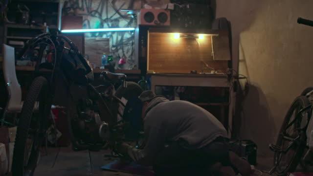 Motorcycle Repair Man using welding to repair his motorbike handbook stock videos & royalty-free footage
