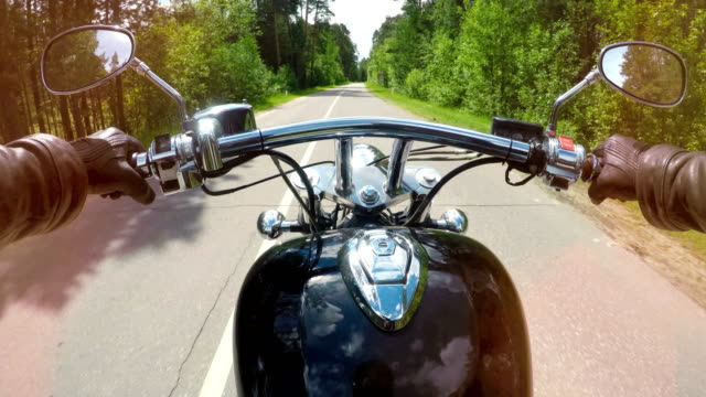 A motorcycle ride in the first view with handles, levers and mirrors visible. 4K. A motorcycle ride in the first view with handles, levers and mirrors visible. motorcycle stock videos & royalty-free footage