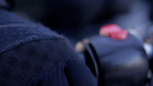Motorcycle rider in black gloves checks motorbike handle video