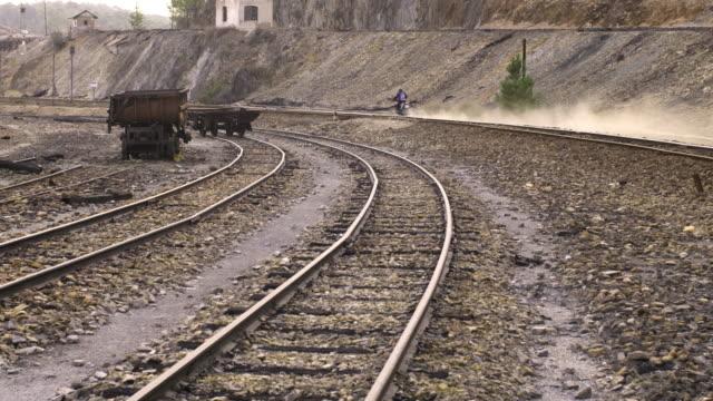 Motorcycle rides along train tracks