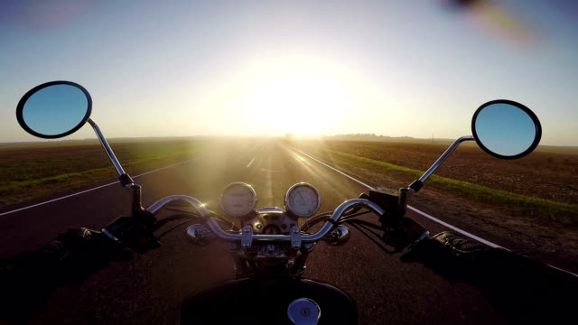 Motorcycle riding towards sunset. Classic cruiser/chopper forever!