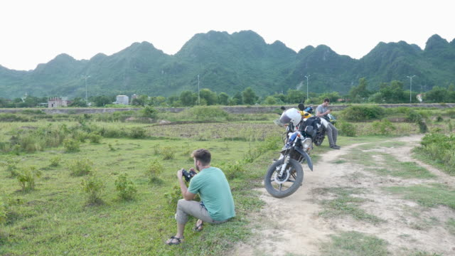Motorcycle Travelers Taking a Break to Photograph the Vietnamese Countryside video