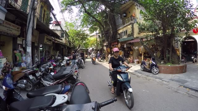 Motorcycles and scooters passing by on the busy streets of Hanoi Vietnam Asia video