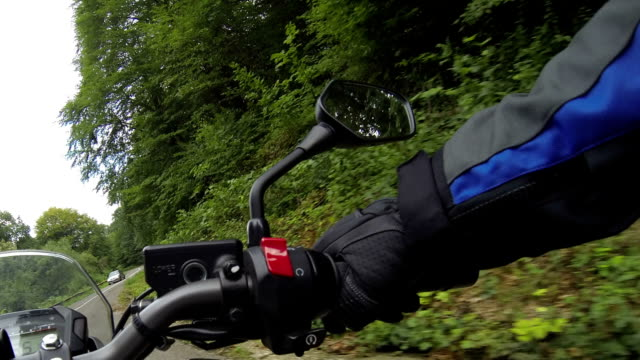 Motorcyclist driving time lapse Motorcyclist driving time lapse. handlebar stock videos & royalty-free footage