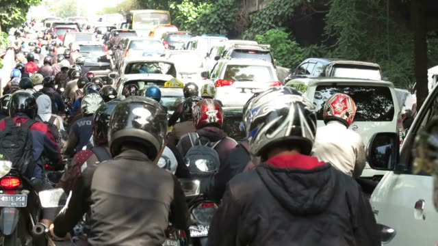 Motorcyclist in Jakarta, Indonesia Traffic situation in one of the main roads in Jakarta, Indonesia on weekdays. jakarta stock videos & royalty-free footage