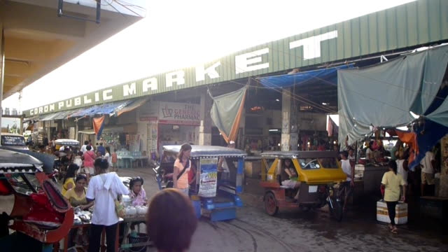 Motorized tricycle in Philippines local market video